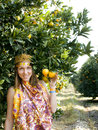 Pretty islam woman in orange grove smiling close up Royalty Free Stock Photos