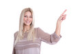 Pretty isolated blond business woman pointing with her finger. Royalty Free Stock Photo