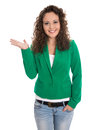 Pretty isolated business woman in green presenting with hand.