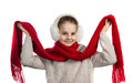 Pretty joyful little girl in warm winter things with knitted scarf Royalty Free Stock Photo