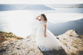 Pretty lady, bride posing in a wedding dress near sea on sunset Royalty Free Stock Photo