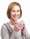 Pretty  lady enjoying a cup of coffee isolated Stock Photo
