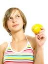Pretty lady with a fresh lemon Royalty Free Stock Photo