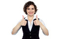 Pretty lady gesturing double thumbs up Stock Photo