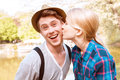 Pretty lady giving cheek kiss to his boyfriend Royalty Free Stock Photo