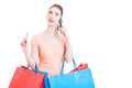 Pretty lady holding shopping bags calling mobile with idea gestu Royalty Free Stock Photo
