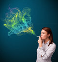 Pretty lady smoking cigarette with colorful smoke Royalty Free Stock Photo