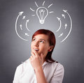 Pretty lady thinking with arrows and light bulb young standing overhead Royalty Free Stock Photo