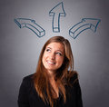 Pretty lady thinking with arrows overhead beautiful young Royalty Free Stock Photos