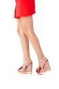 Pretty legs in mini skirt and high heels Royalty Free Stock Photography