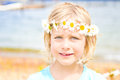 Pretty Little Blond Girl with a Crown of Daisies Royalty Free Stock Photo