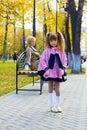 Pretty little girl in autumn park. Stock Image