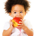 Pretty little girl biting an apple Royalty Free Stock Photo
