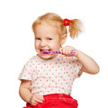 Pretty little girl brushing teeth. Stock Photo