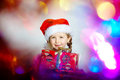 Pretty little girl dressed in santa red hat, new year portrait w Royalty Free Stock Photo