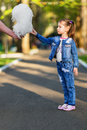 Pretty little girl eating cotton candy shallow dof Stock Photography