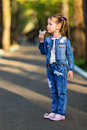 Pretty little girl eating cotton candy shallow dof Royalty Free Stock Images