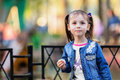 Pretty little girl eating cotton candy shallow dof Royalty Free Stock Photos