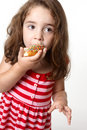 Pretty little girl eating a doughnut Stock Photography