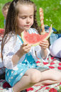 Pretty little girl eating watermelon in the park Royalty Free Stock Photos