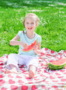 Pretty little girl eating watermelon in the park Royalty Free Stock Photo