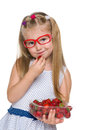Pretty little girl eats strawberry a on the white background Royalty Free Stock Image