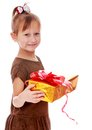 Pretty little girl with a gift in their hands Royalty Free Stock Photo
