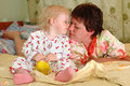 Pretty little girl and her mother playing. Royalty Free Stock Photo