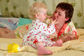 Pretty little girl and her mother playing. Stock Photography