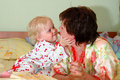 Pretty little girl and her mother playing. Royalty Free Stock Photography