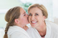 Pretty little girl kissing her mother on cheek Royalty Free Stock Photo
