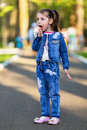 Pretty little girl licking her own fingers after eating cotton candy shallow dof Stock Photography