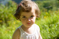 A pretty little girl looks at the camera and smiles Royalty Free Stock Image