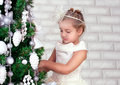 Pretty little girl  near the new year tree Royalty Free Stock Photography
