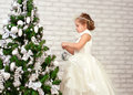 Pretty little girl  near the new year tree Stock Photography