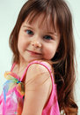 Pretty little girl in pink dress Stock Image
