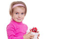 Pretty little girl in pink holding gift box isolated over white Royalty Free Stock Images