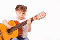Pretty little girl plays an old concert guitar Royalty Free Stock Photography