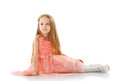 Pretty little girl posing in smart pink dress on white Stock Images