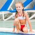 Pretty little girl in swimming near pool Royalty Free Stock Images