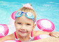 Pretty little girl in swimming pool smiling Stock Photography