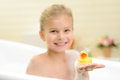 Pretty little girl taking bath Royalty Free Stock Photo