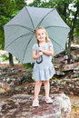 Pretty little girl with an umbrella Stock Images