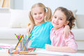 Pretty little sisters painting Royalty Free Stock Photo