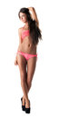 Pretty long haired brunette advertises pink bikini isolated on white Royalty Free Stock Photography