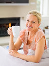 Pretty mature woman having a cup of coffee Stock Photos