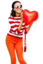 Pretty mixed race girl holding red heart balloon teenager Stock Photography
