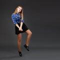 Pretty modern slim hip-hop style teenage girl jumping dancing on