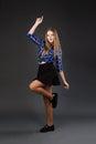 Pretty modern slim hip-hop style teenage girl jumping dancing on Royalty Free Stock Photo