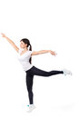 Pretty modern woman jumping dancing isolated on a white studio background Royalty Free Stock Photo